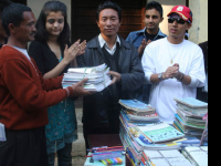 reknown person distributing books