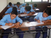 Students participating in a drawing competition organized by a child club