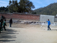 Adrien, Int coordinator, playing football with students at school
