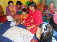 Parents participating in a group work at the training