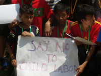 Winner team of inter child club football tournament holding slogan