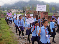Students at rally with placard on the occasion of children's day