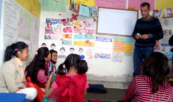 Mr. Adrien Darde,Int.coordinator taking a class for child laborers